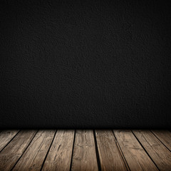 Black wall and wooden floor interior