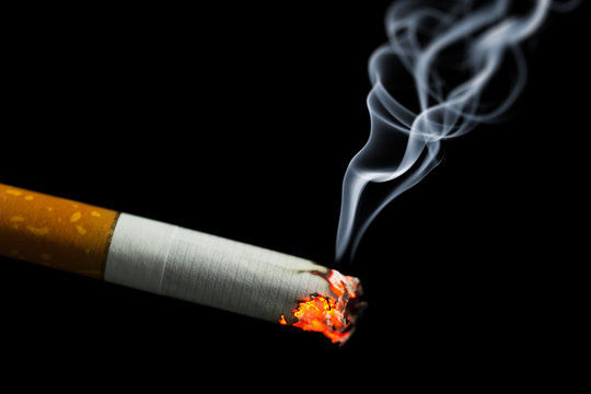 burning cigarette with smoke