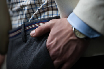 Close up hand in a pocket