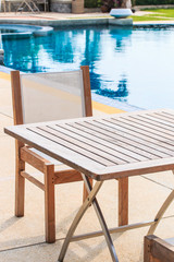 Table and chairs beside the pool