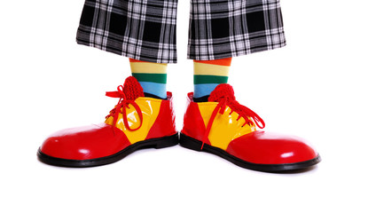 Closeup of clown shoes on white background