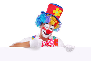 Happy clown holding the blank board showing thumbs up