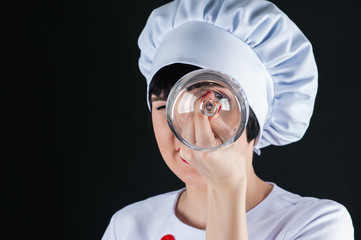 chef looking for a glass isolated on a black background