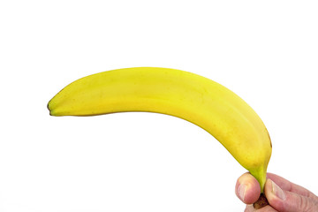 Hand holds banana as a gun