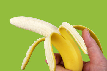 Hand holding peeled banana like a gun
