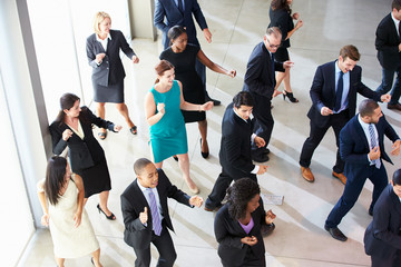 Fototapete - Overhead View Of Businesspeople Dancing In Office Lobby