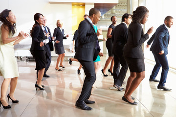 Fototapete - Businessmen And Businesswomen Dancing In Office Lobby