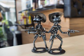 Couple gunman metal doll