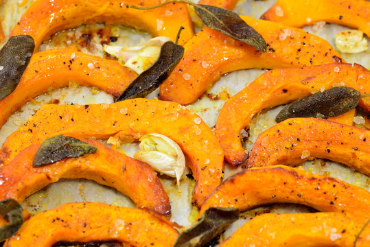 Baked butternut squash and herbs.Roasted vegetables