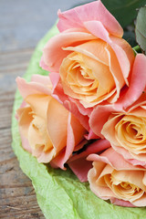 Bouquet of beautiful roses on wooden background