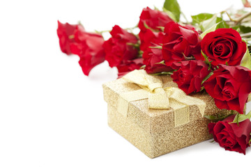 Bouquet of red roses and gift box on white background