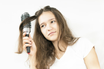 woman combing her hair comb round