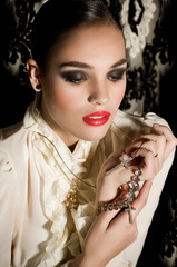Portrait of beautiful young woman with makeup with jewelry
