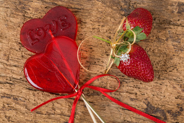 strawberries, heart shaped candies and diamond ring