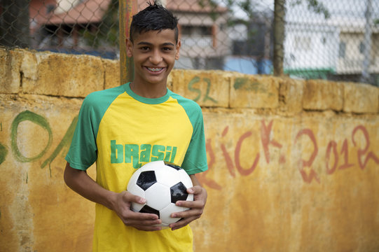 Smiling Brazilian Teen Standing with Football Soccer Ball