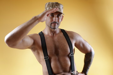 Soldier in uniform and muscular body