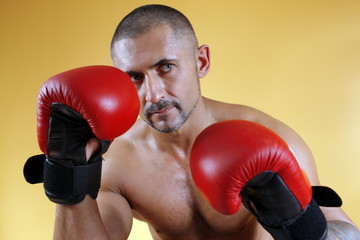 Boxer in red boxing gloves