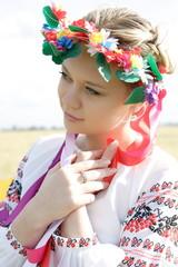 Ukrainian woman in national costume in a field