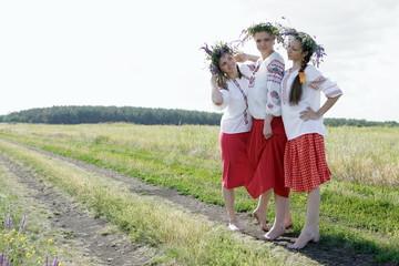 Three Ukrainian girls in national costumes