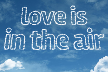 Love is in the Air text on clouds