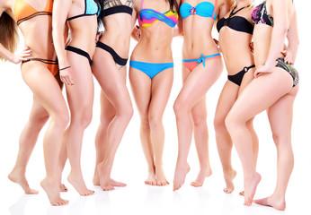 group of girls in bikini, seven attractive caucasian young women