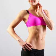 slim waist of young sporty woman, detail of perfect fit female b