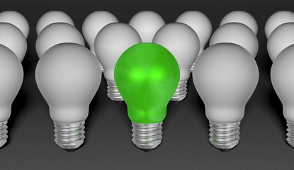 One green light bulb among grey ones on grey background