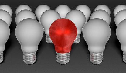 One red light bulb among grey ones on grey background