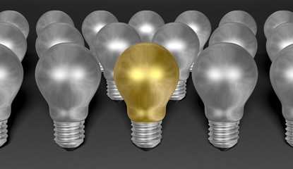 One golden light bulb among many silver ones on grey background