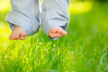 Baby feet over grass