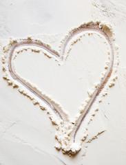 Heart sign on the flour