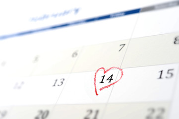calendar page and little red heart marking valentines day