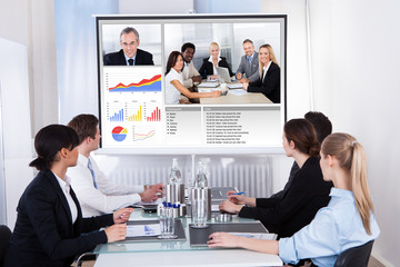Businesspeople In Video Conference At Business Meeting