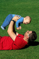 A father and a son enjoy happy time playing in the park