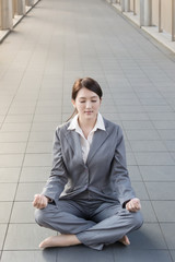 business woman do lotus position