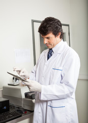 Researcher Using Digital Tablet In Medical Lab