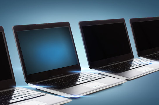 many laptop computers with blank black screens