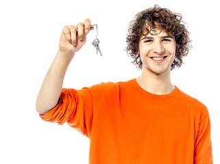 young man holding keys portrait