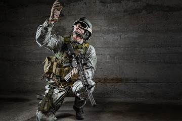 Soldier with mask looking up