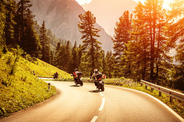 Fototapete - Group of motorcyclists on mountainous road