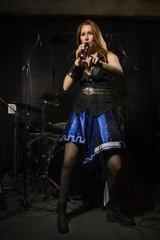 Rock star girl singing in a studio
