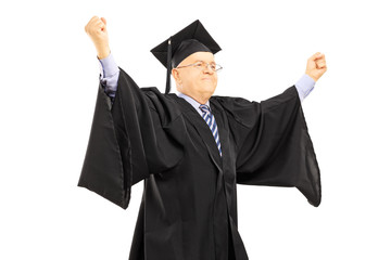 Mature man in graduation gown gesturing success