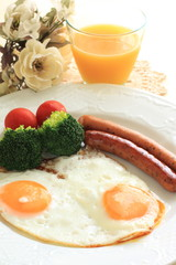 sunny side up egg and pan fried sausage for breakfast image