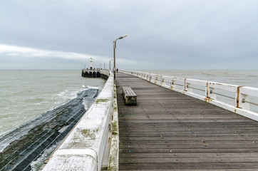 Wooden pier entrance of North Sea port in Nieuwpoort