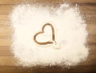 Flour on the table with heart