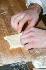 Baker preparing chocolate croissant