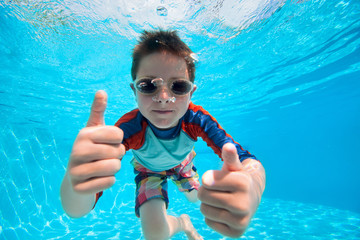Boy swimming underwater