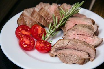 Juicy steak on the plate with tomatoes