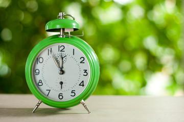 Clock showing five to twelve
