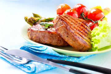 Steak. Grilled Beef Steak Meat with Vegetables